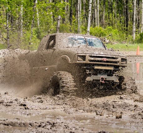 Ute driving offroad in the mud course 4WD