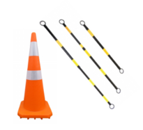 orange reflective road cone and yellow and black cone barriers