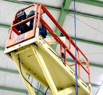 Man training to operate a scissor lift during a elevated work platform ewp course