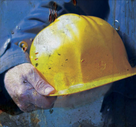 Man holding a yellow safety hard hat