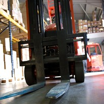 Forklift in warehouse course